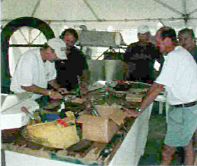 A group effort: Workshop attendees at EAA AirVenture Oshkosh 2002 making an oil tank for the Swallow. Some of these guys are skilled pros!