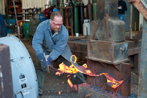George Schroeder is hot-forging with his BIG hammer
